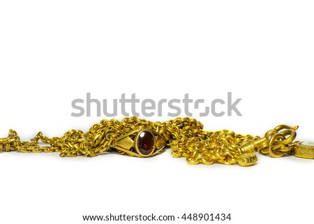 Golden jewelry and ring isolated over white background
