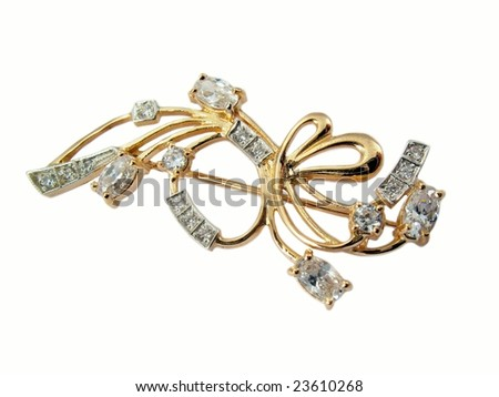 Golden jewelry brooch isolated on a white background
