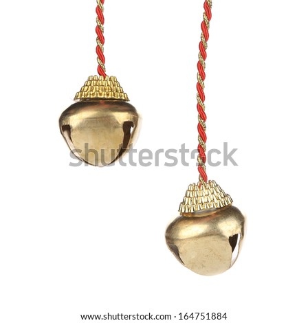 Golden jingle bells on a rope. Isolated on a white background. - stock photo