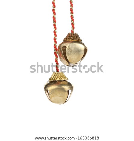 Golden jingle bells on a rope. Isolated on a white background.