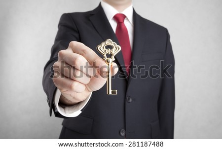 Golden key in businessman hand with clipping path - stock photo