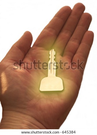 Golden key in person's hand.