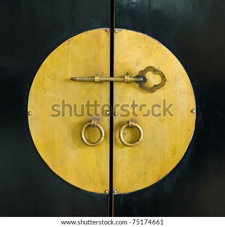 golden key in the door of old cabinet wood