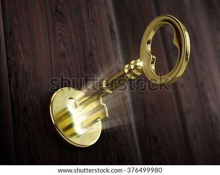 Golden key moving in keyhole - stock photo