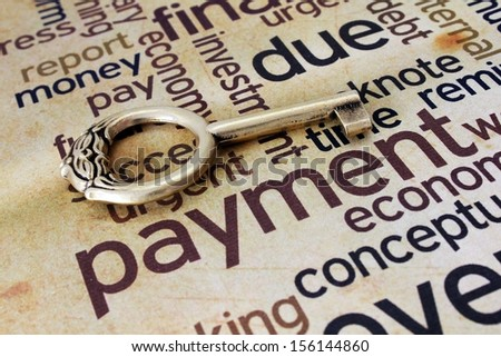 Golden key on payment text - stock photo