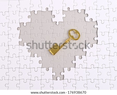 golden Key with heart shape puzzle - stock photo