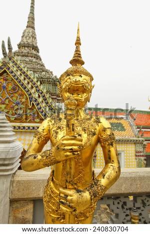 Golden Kinnara Statue at Emerald Buddha Temple in Grand Palace, Bangkok, Thailand - stock photo