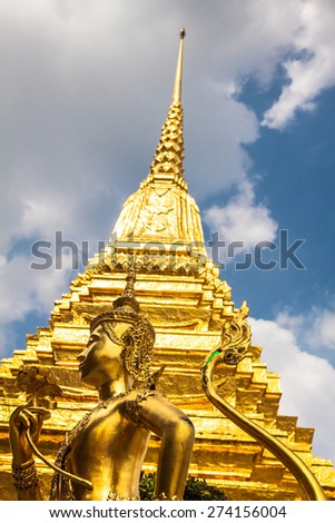 Golden Kinnari statue at Temple of Emerald Buddha (Wat Phra Kaew) in Grand Royal Palace. Bangkok, Thailand - stock photo