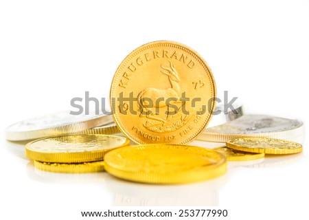 golden krugerrand standing on edge - stock photo