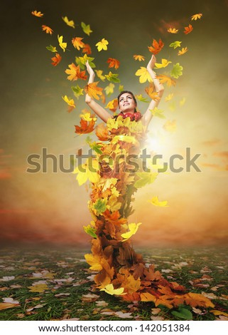 Golden Lady Autumn in the sun rays shining - stock photo