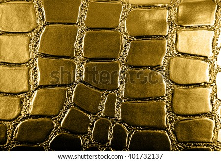 Golden leather texture as background closeup