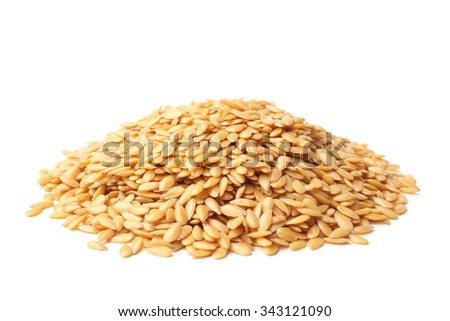 Golden linseed on white background - stock photo