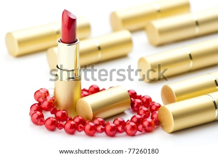 golden lipsticks and red jewelry