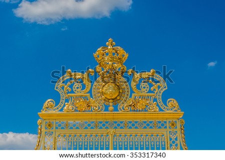 Golden Main Gates of the Versailles Palace. The Palace Versailles was a royal chateau. It was added to the UNESCO list of World Heritage Sites. Paris, France.
