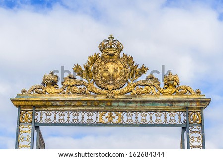 Golden Main Gates of Versailles Palace. Palace Versailles was a royal chateau. It was added to UNESCO list of World Heritage Sites. France.