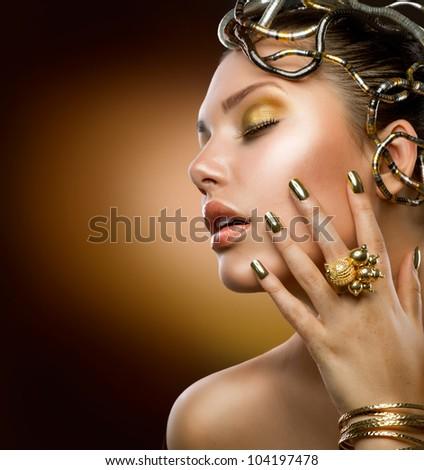 Golden Makeup.Fashion Girl Portrait - stock photo
