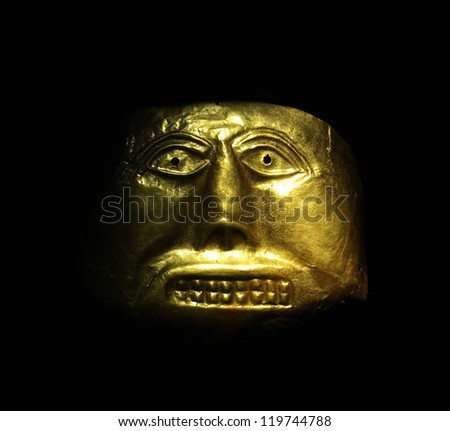 Golden mask in the Gold Museum, Bogota, Colombia. Tolima culture, Pre-Columbian America - stock photo