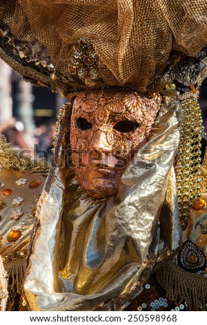 Golden mask with decorations and carvings during the Carnival of Venice 2015 edition. - stock photo