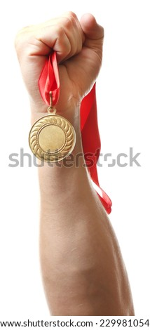 Golden medal in hand isolated on white - stock photo