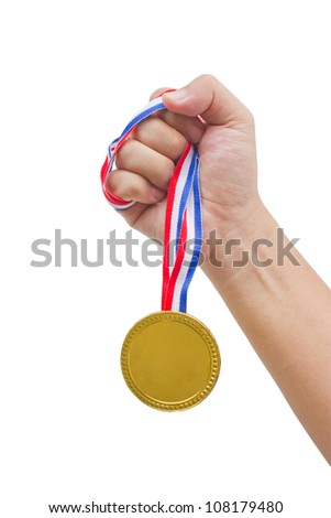 Golden medal in man's hand isolated on white background. - stock photo