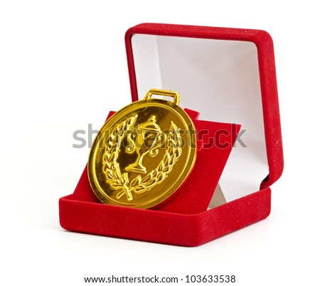 Golden medal in red gift box. white background