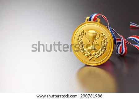 golden medal office on the gray background - stock photo