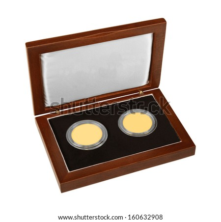 Golden medals in wooden box isolated on white background - stock photo