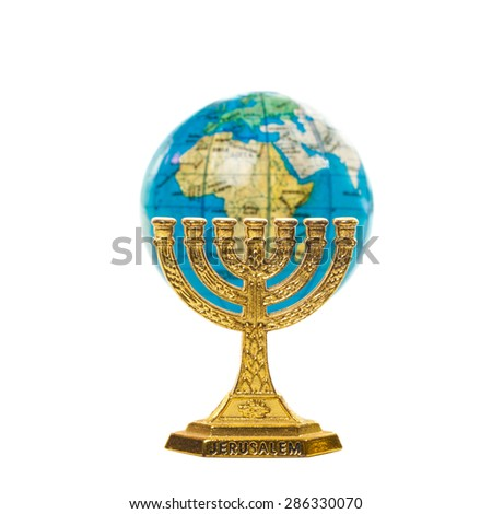 Golden Menorah and globe in shallow DOF isolated on white background - stock photo