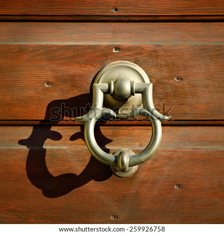 Golden metal door handle, Italy - stock photo