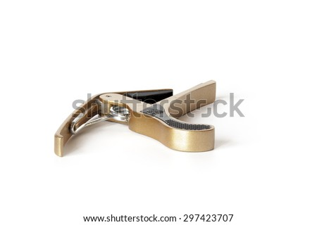 Golden metal guitar Capo isolated on white