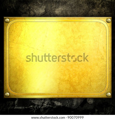 golden metal plate on concrete wall