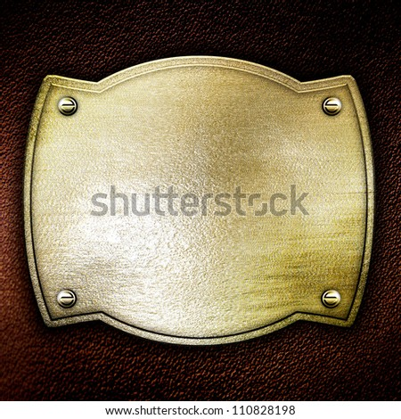 golden metal plate on leather background