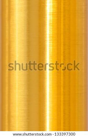 Golden metal surface closeup - stock photo