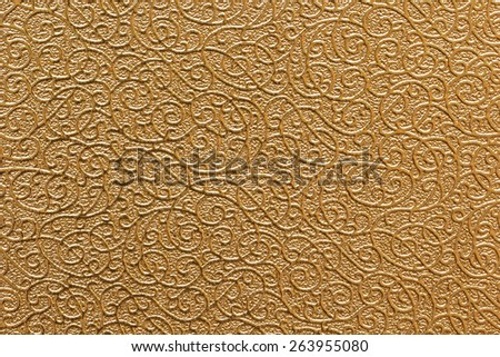 Golden metal texture used as background, Golden floral ornament brocade textile pattern - stock photo