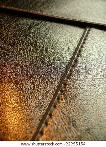 Golden  metallic leather texture close up. More of this motif & more textiles in my port. - stock photo
