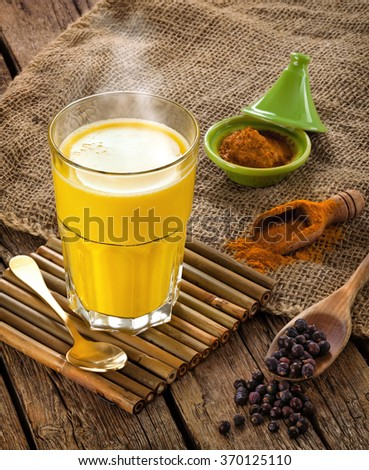 Golden Milk, made with turmeric. Remedy for many diseases. - stock photo