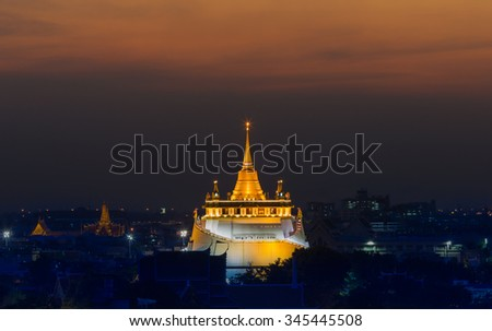 Golden Mount Temple or Wat Sarket, the most famous landmark in Bangkok Thailand with beautiful sky after sunset  - stock photo