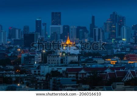 Golden mountain, an ancient pagoda at Wat Saket temple in Bangkok, Thailand at night. - stock photo