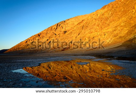 Golden Mountain, Reflecting Salt Earth at Death Valley - stock photo