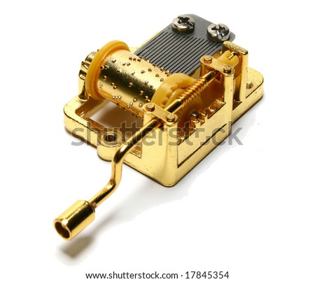 Golden music box on white background - stock photo
