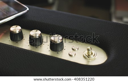 golden music controller button on vintage filter - stock photo