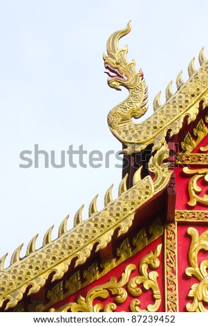 Golden naga on temple roof, Lamphun, Thailand