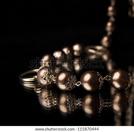 golden necklace over black - stock photo