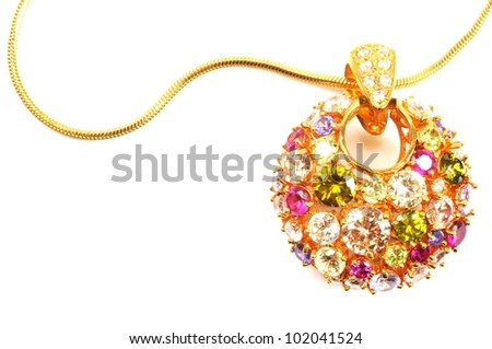Golden necklace with colorful gems , over white - stock photo