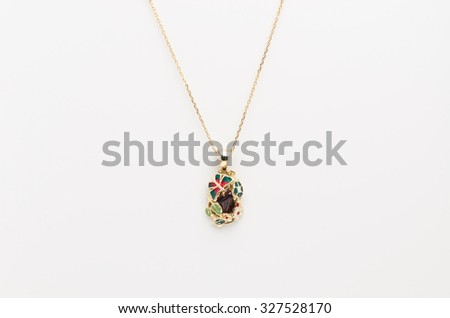 Golden necklace with pendant isolated on the white background
