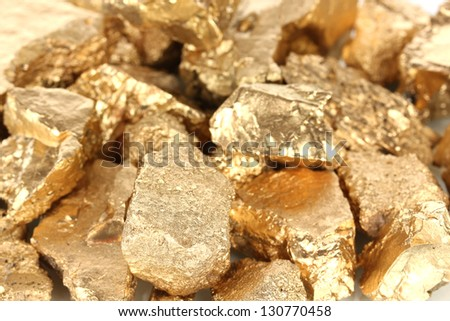 Golden nuggets close-up - stock photo