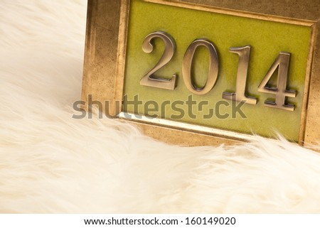 Golden numbers 2014 in a vintage picture frame, the New Year's theme  - stock photo
