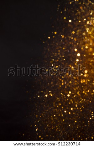 Golden overlay background of golden lights with bokeh effect. Includes copy space.