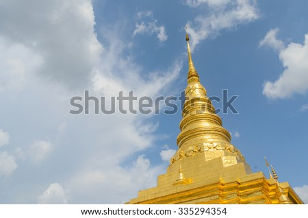Golden pagoda and blue sky in Phra That Chae Haeng temple, nan province thailand - stock photo