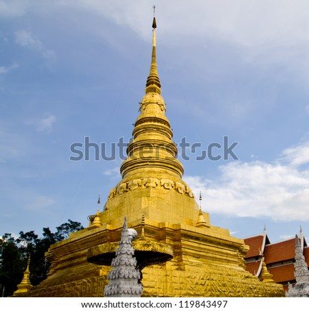 Golden pagoda contains the Holy Buddha Relics which is in Wat Phratat Chare Hang (Nan-Thailand)